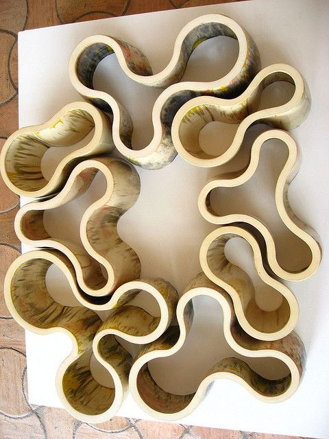 Richard Deacon sculpture      Clean cut, natural materials, organic shapes, simple