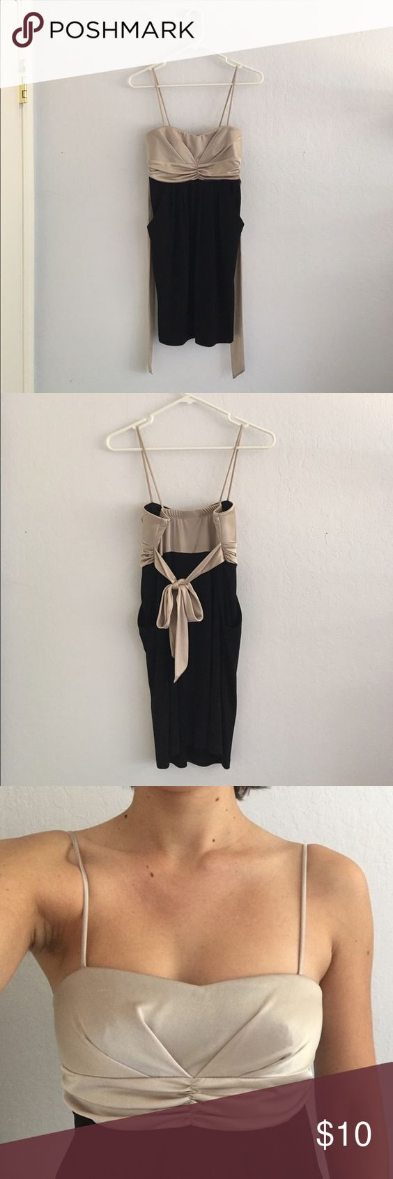 """""""Sweet Storm"""" Black and beige mini dress Size small dress, slightly formal, only worn once. This dress is very comfortable and has a supportive bust. It is a little short but I am 5'11"""" and it reaches down to mid-thigh. Spandex polyester blend. Also, pockets! Sweet Storm Dresses Mini"""