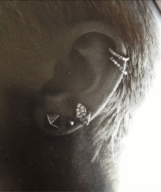 miley cyrus's ear piercings... like the double cartilage rings. THIS IS EXACTLY WHAT I WANT