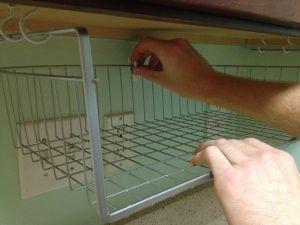 Under cabinet shelf basket turned into a hanging a bread basket