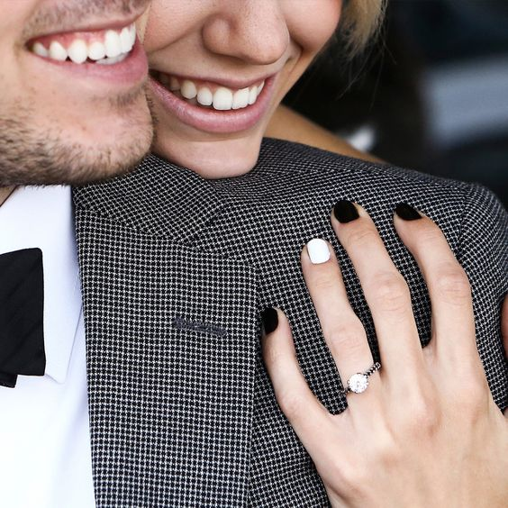 Love this ring selfie and her black and white nails
