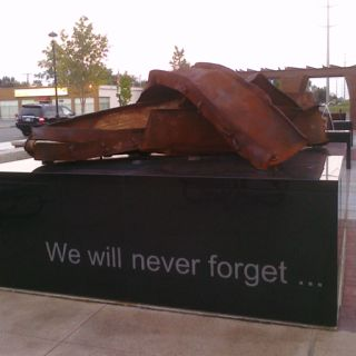 A piece of the rubble from the World Trade towers . Now on display at First Responders Park in Hilliard , Ohio. We will never forget 9/11.