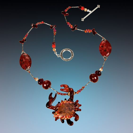 Beautiful art glass red crab necklace.