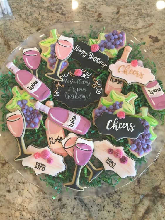 Wine themed cookies for a girls night in wine party #wineparty #winepartyideas #girlsnightin #girlsnight #winecookies #winethemedcookies #winedecor #winedecorations