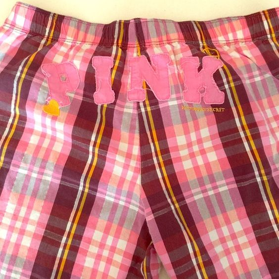 PINK plaid pajama pants - S PINK Victoria's Secret pink pajama pants. PINK on rear; like patches sewn in with some loose threading. Has the colors of pink, white, gray, marigold and dark stripes, with silver metallic thread. White tie in front. One little pocket in left front. Can roll up the hem and button in place. 99% cotton, 1% other (probably the metallic). It's a lightweight cotton. Previously worn. PINK Victoria's Secret Intimates & Sleepwear Pajamas
