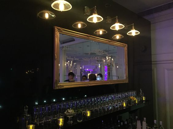 Custom Bar consisting of Custom Graphics on a bought mirror and fixings to compliment