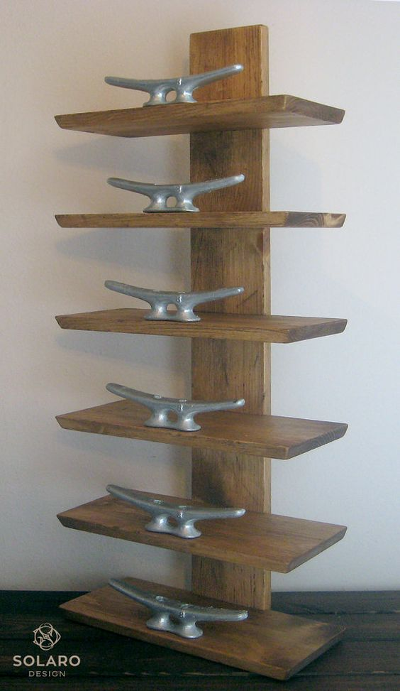 Distressed, nautical towel rack with 8 galvanized dock cleats to hold 6 rolled towels in place.  - Keyhole fasteners on the back to hang on a wall.