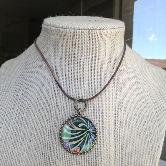 #handmade #leather accessories on Etsy This one of a kind handmade #necklace is made from #japanese #paper treated, and then set in a bezel with resin. The #cord pictured is leather, but feel free to choose from the... #trending #etsy #unique #jewelry #resin #pendant #silver #copper #print #chain