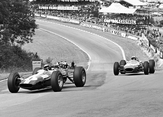 1964 British Grand Prix, Brands Hatch. Jim Clark in a Lotus 25, leads Jo Siffert in a Brabham BT11.