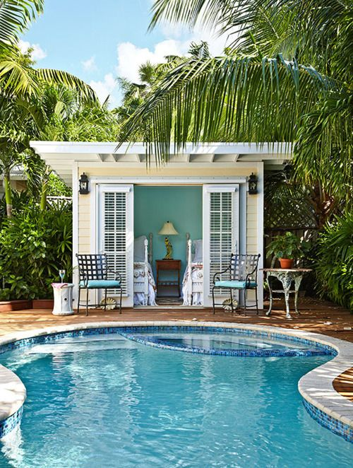 Adorable pool house and sweet tropical pool/landscaping...