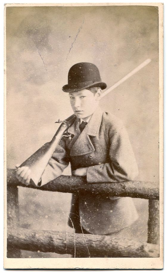 Carte de visite of a boy with a gun and wearing a bowler hat. By J W Clarke of Bury St Edmunds.