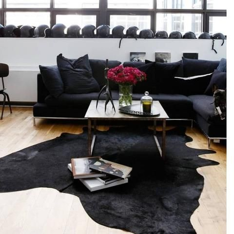 Metallic Cowhide Rug And Leather Poufs Hand In Hand Boho Living Room Leather Couches Living Room Black Leather Couch Living Room Cow Rug Living Room