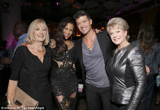 Family night out: Paula Patton and Robin Thicke pose with their mothers Joyce Patton and Gloria Loring at the premiere's after party
