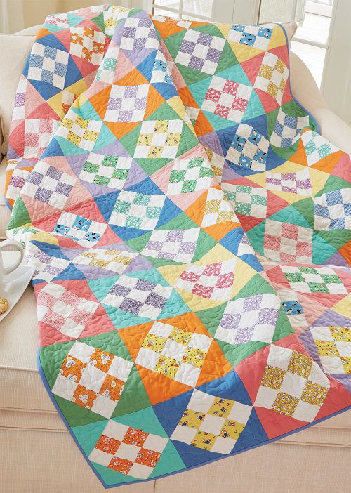 Skip To My Lou Quilt Kit: Nine Patch units made of assorted prints and coordinating solids compose this spunky quilt designed by Debra Finan. It's a great use for pre-cut strips and squares! Kit includes fabric from Marcus Fabrics' Aunt Grace and Centennial Solids collection.