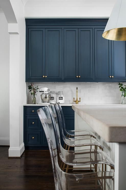 Royal Blue Kitchen Cabinets Adorned With Brass Hardware Are