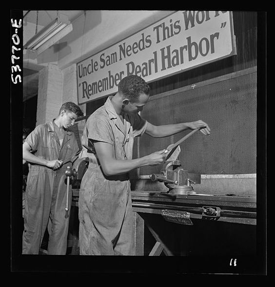 File:Two bench workers removing the burrs from a side piece 8d36001v.jpg