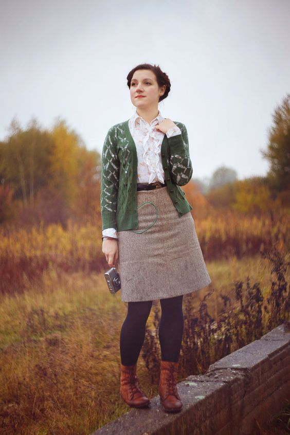 The Robot That Had a Heart: cardigan over a printed blouse tucked into a line skirt with tights and boots