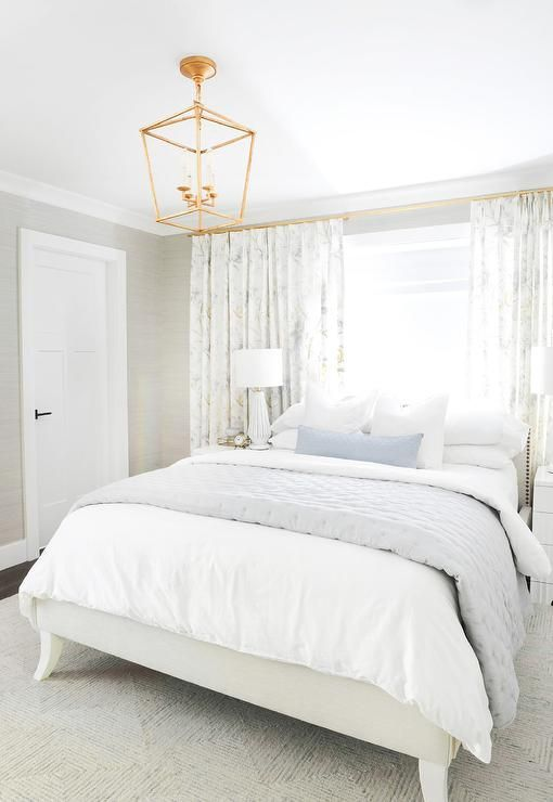 White And Gray Bedroom Featuring A Light Gray Bed With A Low