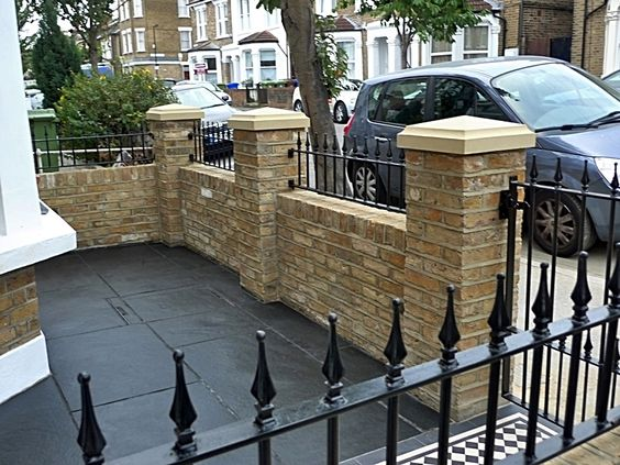 front garden wall and mosaic tiled pavement fence walls