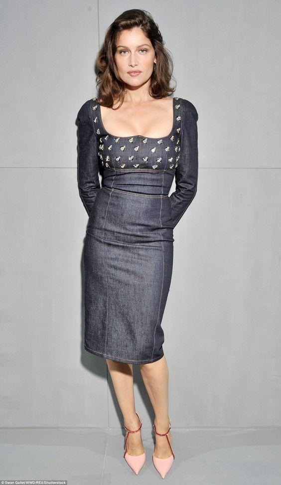 Denim delight: Laetitia Casta put on a busty display in a plunging knee-length Dior denim ...