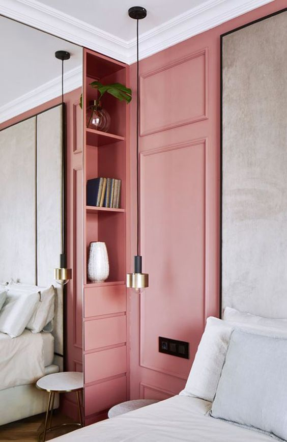 pink walls with molding and built-in bookshelves. / sfgirlbybay