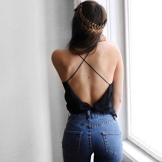 High waist jeans, black cross cross silk top and braid
