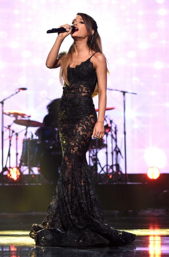This dress was on Rihanna is ariana trying to copy Rihanna style our does she thinks it's better on her