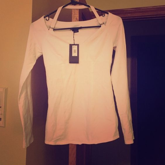 Armani Exchange White halter top New with tags never worn! Paid 48.00+tax. Gorgeous long sleeve halter for all year round. I wish I didn't have to sell but it is too small on me. Armani Exchange Tops