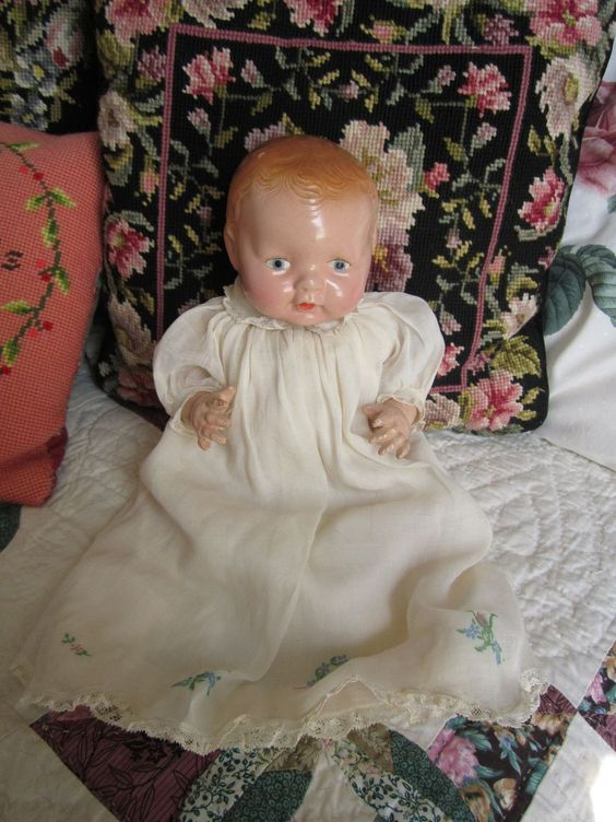 For sale is a vintage unmarked composition doll from the 1930's. Her composition is in excellent shape especially considering her 70 + years. No