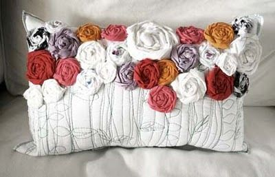 Fabric flowers tutorial for decorating a pillow.