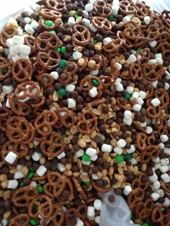 Camo Trail mix! -marshmallows -peanuts -chocolate chips -green M -coco puffs -pretzels (this shape is suppose to look like a deer head)