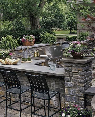 outdoor dining area with stacked stone