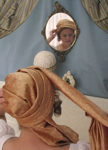wrapping a turban by Lynn McMasters