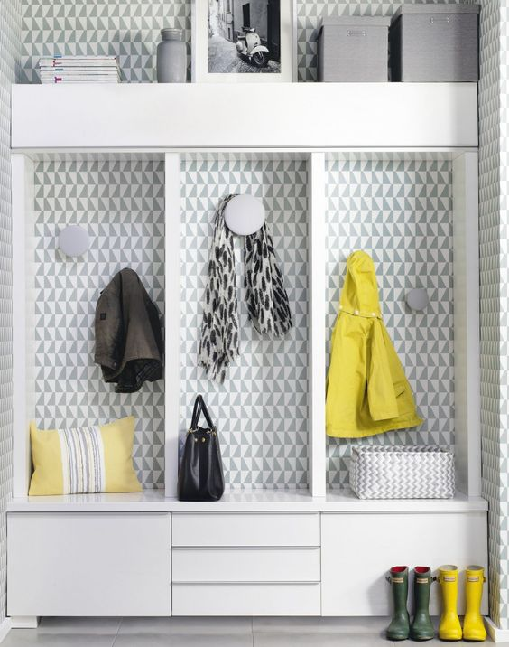 Bring a grey space to life by covering one corner or wall with a busily patterned paper in a tonal grey-green hue. Grey is smart and sophisticated, so stay on message with planned focal points and tight furniture arrangements, like this built-in storage unit.: