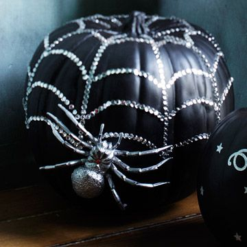 Who says all pumpkins have to be carved?  Spray painted black with silver webbing & attach a spider.  This would be a great idea for a foam pumpkin so you can save it.