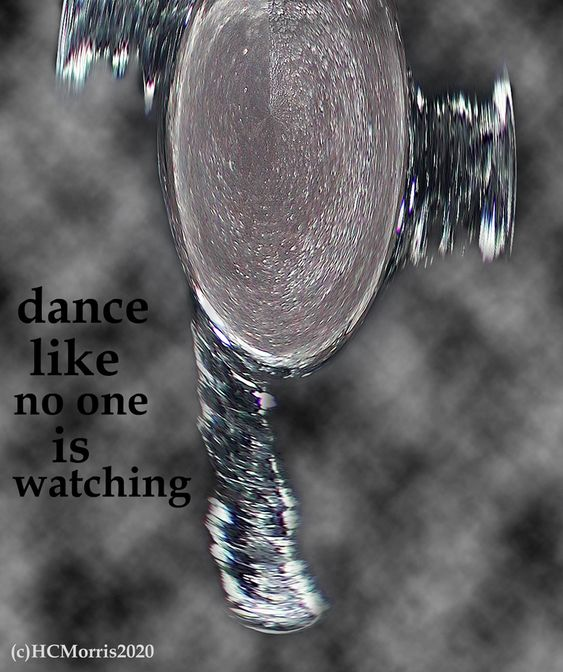 an abstract photo with the words 'dance like on one is watching'
