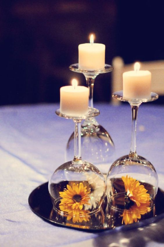 Budget wedding centerpiece idea - candles, mirror, wine glasses and colorful flowers.: