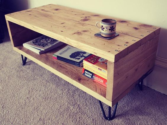 This is a media unit or coffee table made from reclaimed scaffolding boards fixed together with heavy duty coach screws. The addition of the four