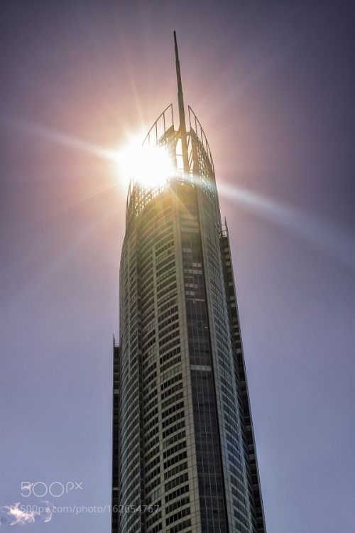Sun Behind The Q1 Tower by JukkaHeinovirta  sky travel sun clouds sunshine tower architecture building windows landmark shine oceania no people