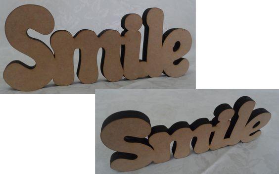 """""""SMILE"""" em MDF cru para decoração de mesa, com espessura para parar em pé sem apoio.  Medidas: 10 x 25 cm  Espessura: 12 mm  Material: MDF cru, sem pintura ou verniz.  Fabricação: corte a laser. http://beijaflorartesanato.lojaintegrada.com.br/smile-de-mesa"""