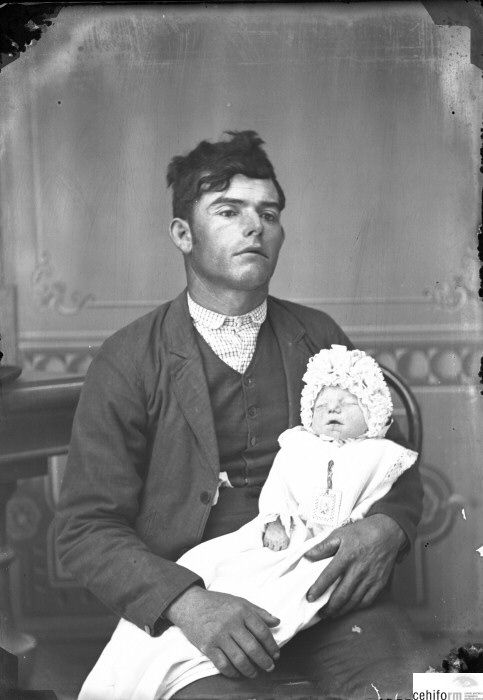 I believe both are deceased.  The baby is obvious but the fathers hands don't seem to be really holding the baby and his face looks...well frozen.