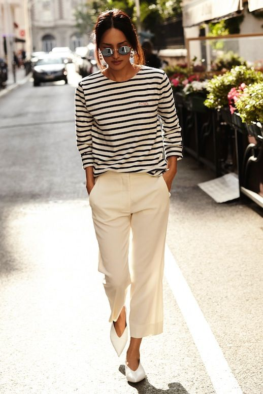Le Fashion Blog Parisian Style Low Bun Mirrored Round Sunglasses Striped Long Sleeve Shirt Cropped Cream Pants White Pointed Celine Flats Via Gary Pepper: