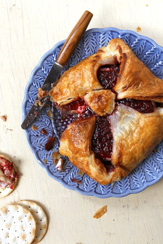 There's a reason this recipe is a classic party appetizer: crowned with jam and wrapped in puff pastry, a wheel of brie turns into a gooey, irresistible treat that's great eaten with crackers or toast.