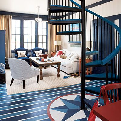 Show Stopper    Call attention to a room's architectural elements, such as trim and molding, by painting them deep navy. You can also wake up a plain floor with paint. Here, thin stripes of white outline alternating shades of blue.