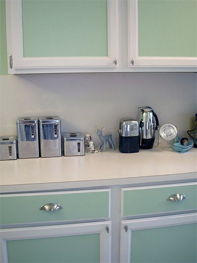 I want to paint my kitchen in pale teal and white, with brushed steel fixtures, and a teal tile mosaic backsplash.