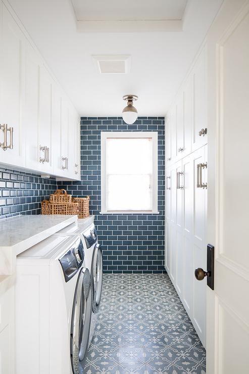 Clark Flush Mount Illuminates White And Blue Mosaic Floor Tiles Accenting A Laundry Room Clad In Peaco White Laundry Rooms Blue Subway Tile Laundry Room Design