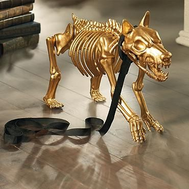 Gold Skeleton Dog. We can already hear the shrieks of delight, as guests step into your chamber of glam, only to encounter our Gold Skeleton Dog nipping at their heels.  You can be certain that no one else will have one.  Halloween Black & Gold Glam Gala Party Decorating Ideas