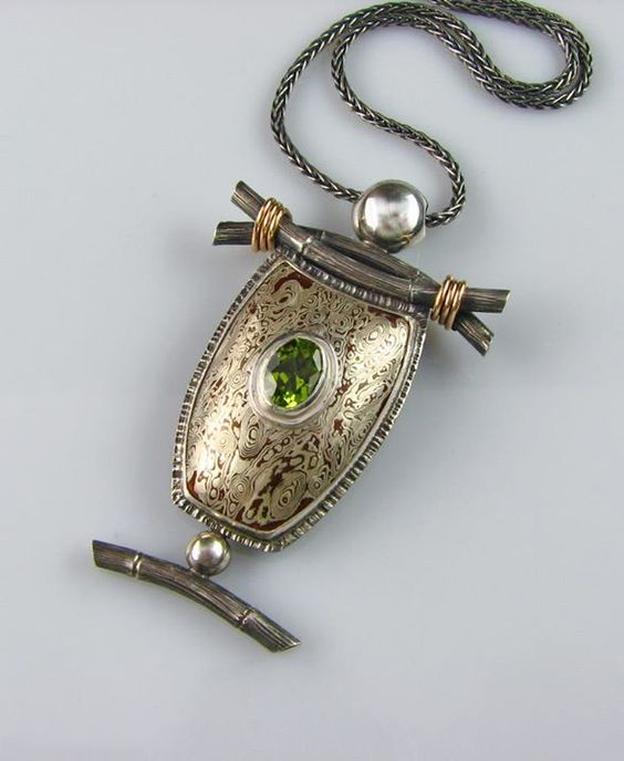 John Sartin Designs  |  Copper/sterling Mokume Gane Pendant with sterling silver and 14k gold accents, featuring a natural Peridot.