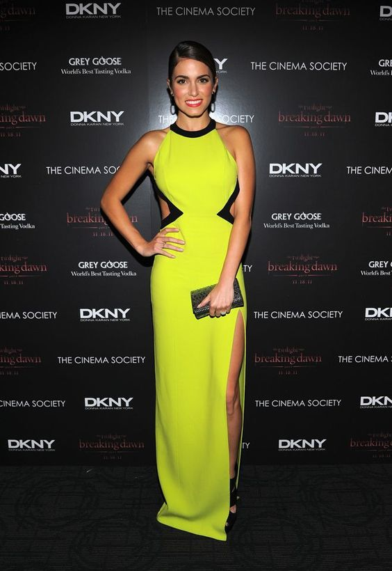 Nikki Reed wearing a neon Michael Kors dress from the 2012 Resort Collection