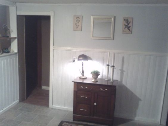 small cottage dining room blue white wainscotting trim with gold accents